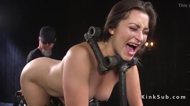 Brunette in metal device pussy vibed