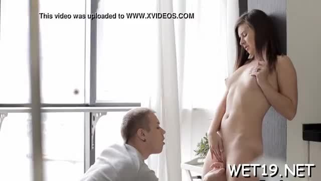 Charming guy is pounding cute babe roughly doggy style